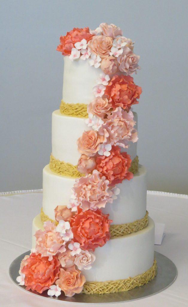 Coral Blush Floral Cascade Wedding Cake